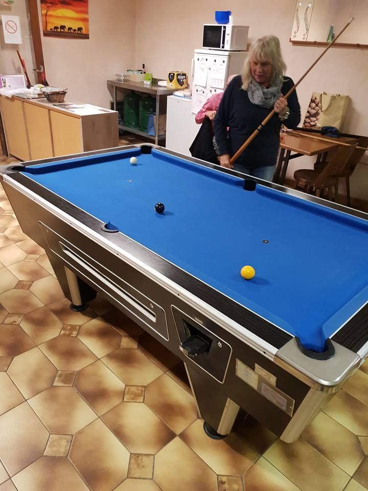 Sharon playing pool